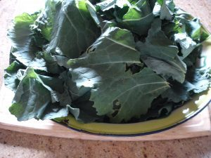Collard greens on table.