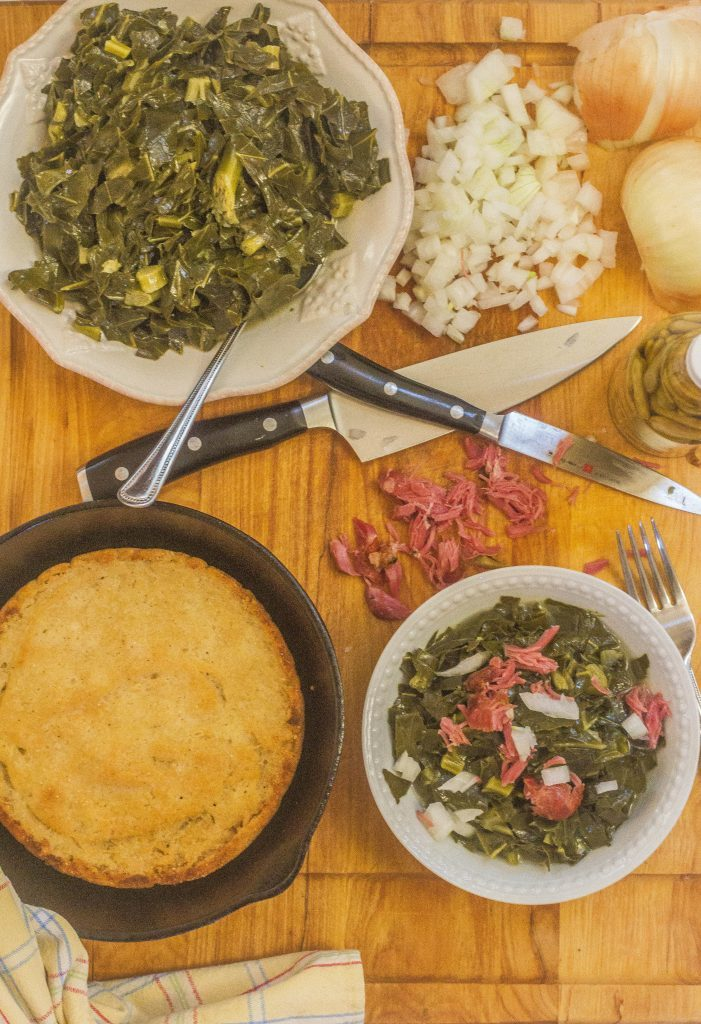 Southern-Style Collard Greens with Ham Hocks. Shredded collards cooked in a rich ham hock stock with touch of honey. Served with fresh sweet onions and hot pepper sauce along with a side of hot water cornbread.