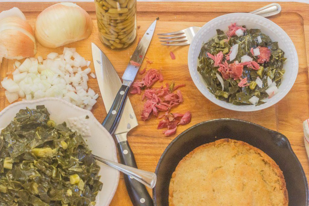 Southern-Style Collard Greens with Ham Hocks in bowls on top of cutting board.