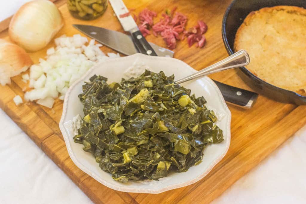 Southern-Style Collard Greens with Ham Hocks in bowl.