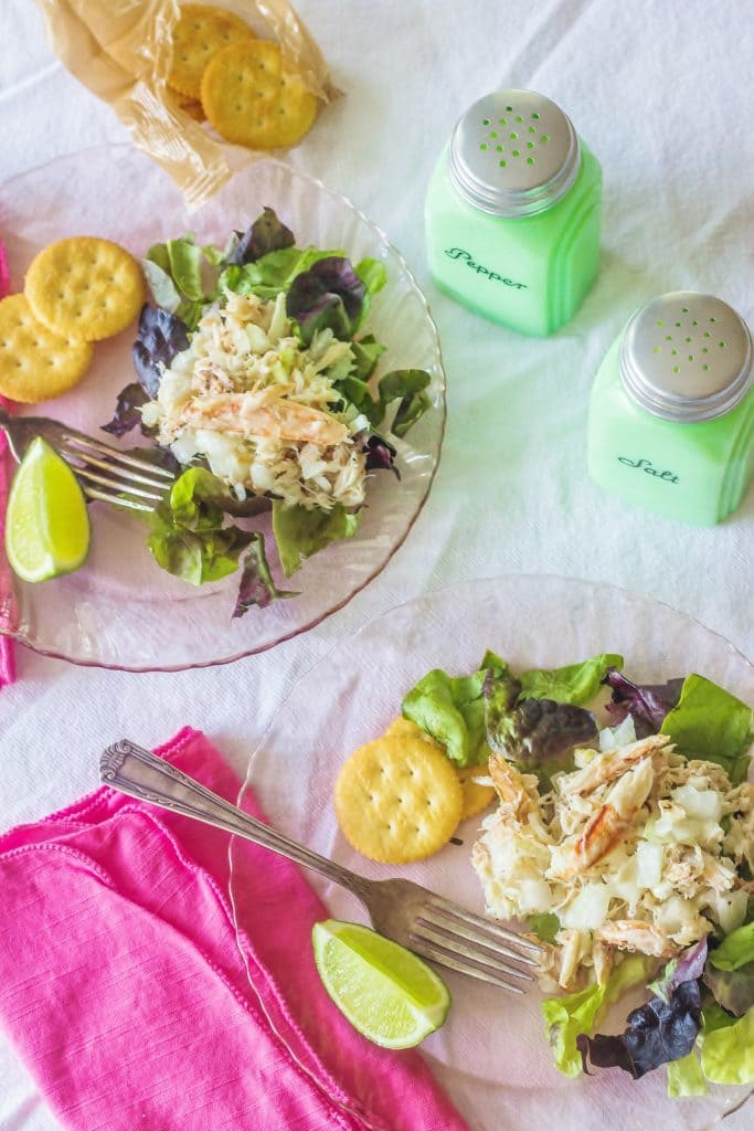West Indies Salad. Fresh crabmeat marinates overnight with sweet onion and vinaigrette. Serve with lemon or lime atop fresh salad greens.
