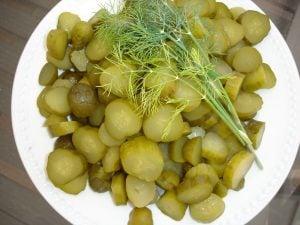 Sliced pickles on plate.