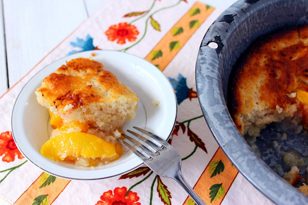Peach Cobbler. An old fashioned dessert made of sweetened cook fruit and a biscuit like topping. #peach #cobbler #southern #food