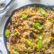 Chicken and Sausage Jambalaya. A one pot meal . Chicken, sausage, vegetables and rice seasoned with Cajun seasoning, cooked in a cast iron skillet.