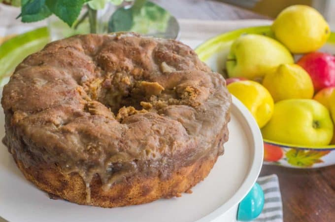 Apple Dapple Cake. A vintage hand-me-down recipe. Fresh apples and pecans are held together by just the right amount of cinnamon vanilla batter. The hot cake is topped with a freshly made caramel glaze. A family favorite.