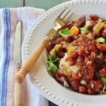 Alabama-style Slow Cooker Red Beans and Rice. Red beans and Conecuh sausage simmer with vegetables in a slow cooker.