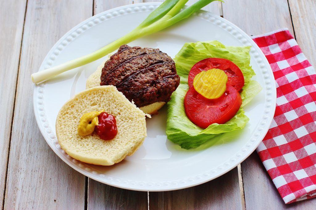 Homemade Grilled Hamburgers. Tips for creating juicy backyard, hand-formed burgers.