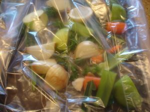 Veggies, herbs, and fruits in oven bag.