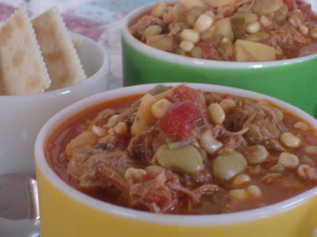 Old Fashioned Brunswick Stew in cups with side of saltine crackers.