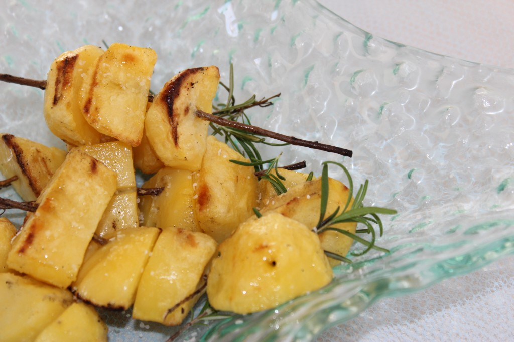 Grilled Rosemary and Garlic Skewered Potatoes. Using rosemary twigs for skewers, the aromatic potato dish cooks on the grill.