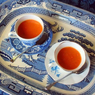 Roasted Carrot Soup. Carrots roasted with aromatics and pureed into a delightful soup.