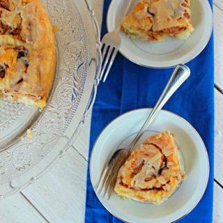 maple syrup cinnamon rolls on a platter