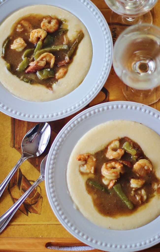 Shrimp and Grits. Gravy of sauteed onions and peppers, ham and shrimp served over creamy, cheesy grits. #southernfood #southern #shrimp #grits