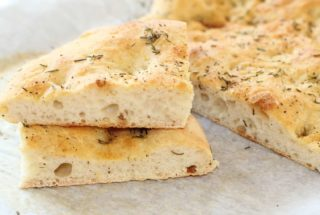 Garlic and Herb Focaccia Bread. Make quick work of this bread by starting off with a frozen loaf of prepared dough. #garlic #herb #focaccia #bread