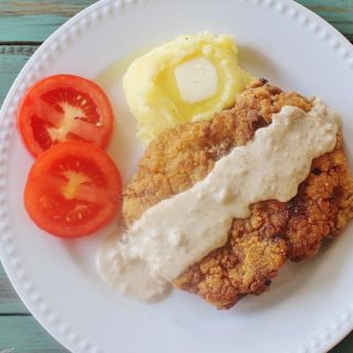 Country Fried Steak with Gravy. Seasoned breaded cube steak fried and served with homemade gravy.