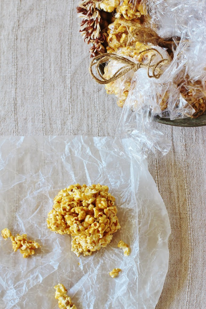 Old Fashioned Popcorn Balls. Freshly popped popcorn coated with a homemade butterscotch-y candy coating.