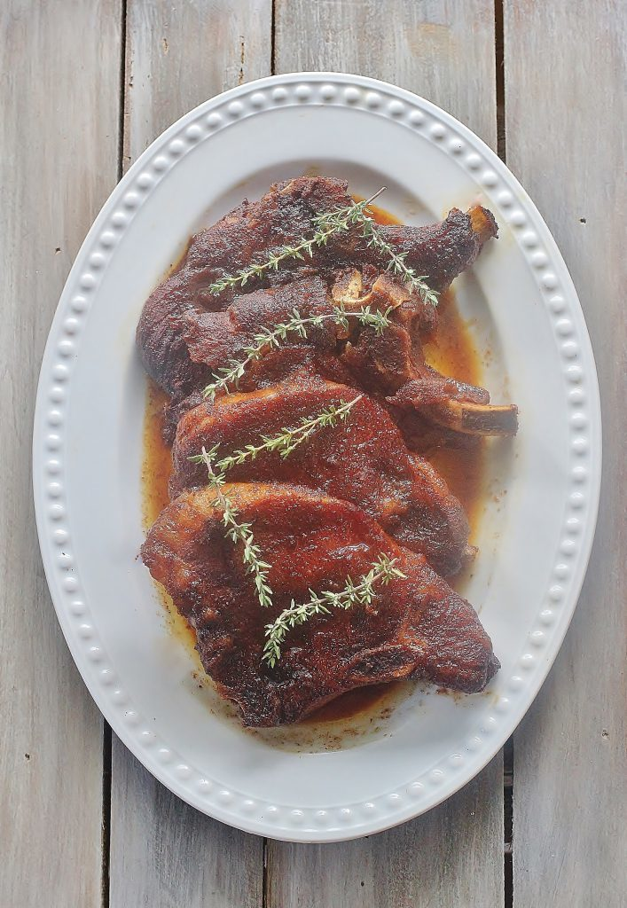 Slow cooker Brown Sugar Pork Chops on plate.