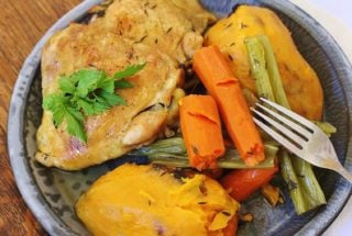 Chicken and Vegetables. A one pot meal of layered vegetables topped with seasoned chicken thighs.
