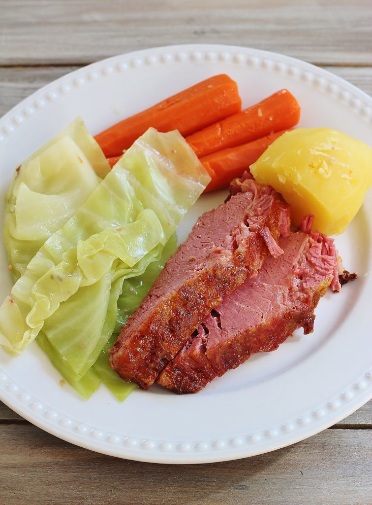 Corned Beef Dinner. Corned beef brisket slow simmered for hours on the stovetop with added cabbage, carrots, and potatoes.