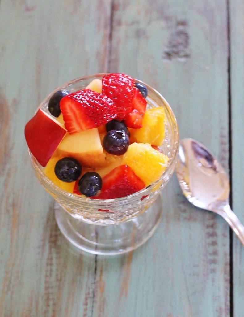 Simple fruit salad with honey citrus dressing. No frills necessary