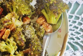 roasted broccoli and pecans on a platter