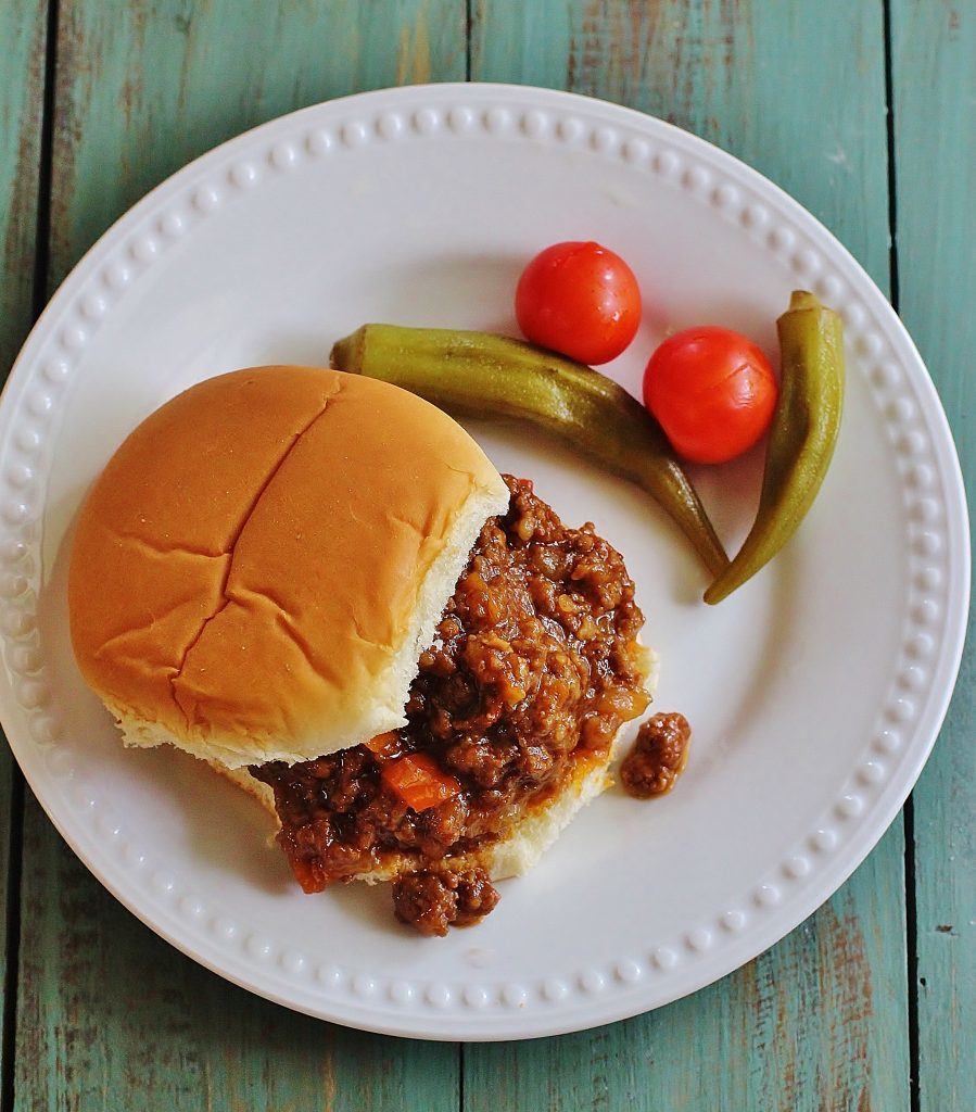 Two Meat Sloppy Joes. Ground beef, ground pork sausage, peppers and onions cooked in a BBQ-y sauce and served over bread or buns.  All American goodness.