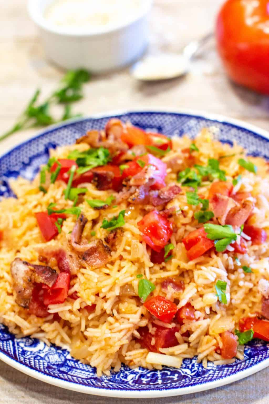 Tomatoes and Rice is an old fashioned, classic Southern family favorite side dish. Sweet onion is sautéed in bacon grease before adding Basmati rice and fresh or canned tomatoes.