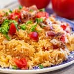 tomatoes and rice on a plate
