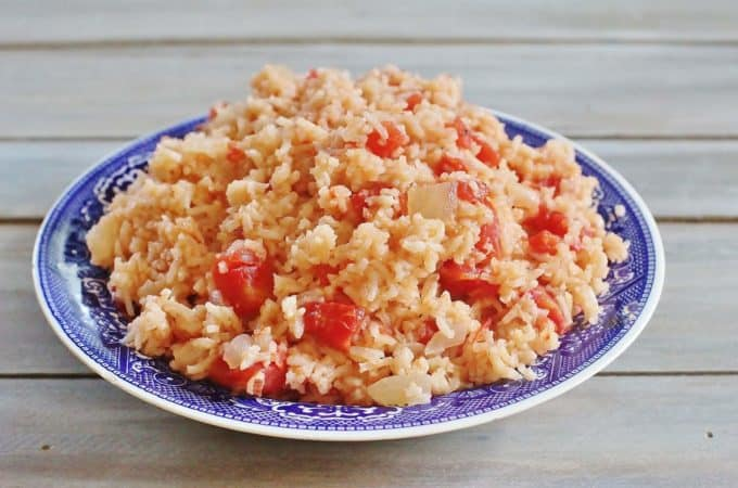 Tomatoes and Rice. Onions sauteed in bacon grease and cooked with frresh or canned tomatoes and rice