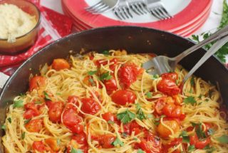 Summer Garden Tomato Sauce and Pasta. Fresh picked summer tomatoes, oregano and parsley cooked with onions and garlic and served with Angel Hair pasta.
