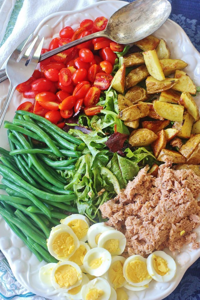 Tuna Nicoise Salad. A hearty salad made with tuna, roasted potatoes, green beans, boiled eggs and fresh tomatoes.