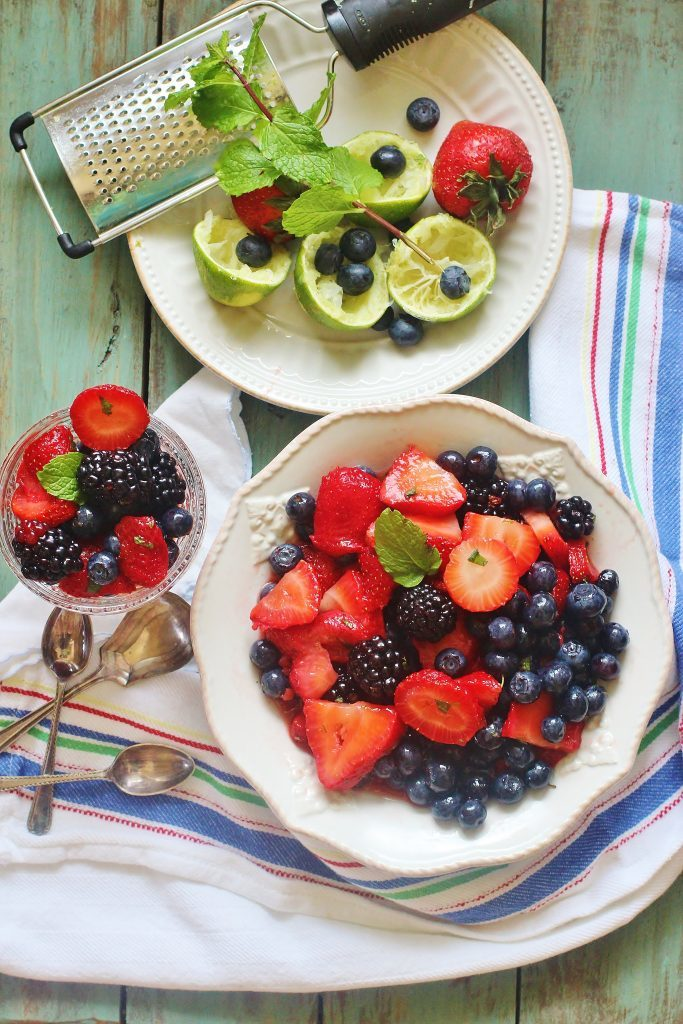 Summer Berry Salad. A simple mix of summer berries with a minty honey lime dressing.
