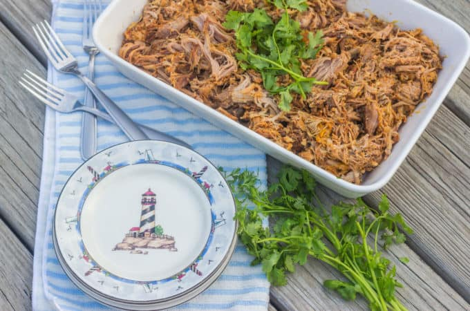 "Slow-cooker Beach House Pulled Pork. A slow-cooker ""clean out your refrigerator"" recipe that starts with a Boston butt pork roast."