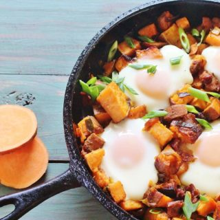 "Sweet Potato Bacon Hash with Baked Eggs. A skillet meal of sweet potatoes, sweet onions, bacon and eggs. From the cookbook ""Sweet Potato Love"" by Jackie Garvin."