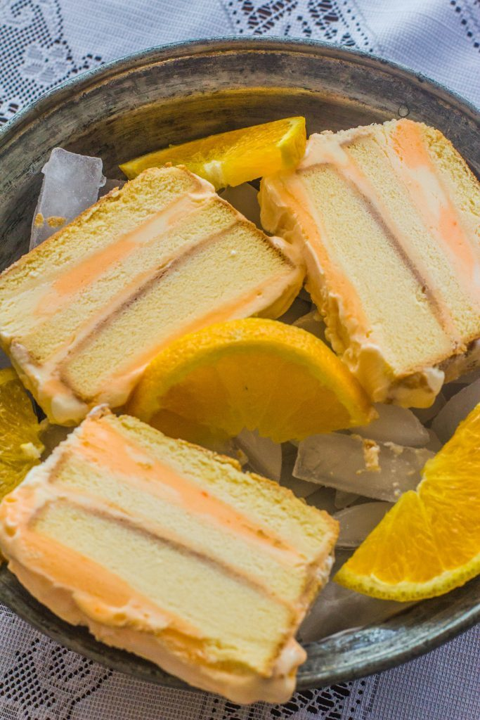 Creamsicle-Inspired Ice Cream Layer Cake. A frozen pound cake, orange sherbet and vanilla ice cream. An easy ice cream treat that will remind you of a childhood favorite ice cream.