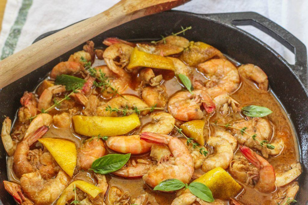 New Orleans-style BBQ Shrimp. Unpeeled shrimp cooked in a buttery Worcestershire broth. Served with lots of crusty bread to sop up the broth.