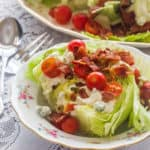 Wedge Salad with Buttermilk Blue Cheese Dressing. Iceberg lettuce, homemade buttermilk blue cheese salad dressing, tomatoes and bacon.