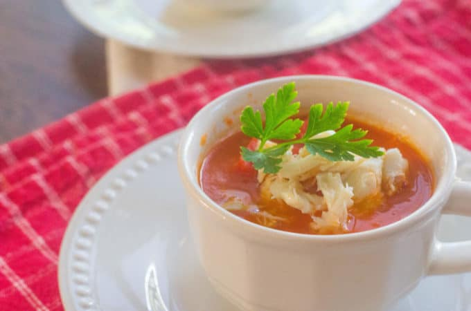 Roasted Red Pepper Tomato Soup with Crab. A twist on a childhood favorite, tomato soup gets updated with the addition of roasted red pepper and a dollop of lump crab meat.
