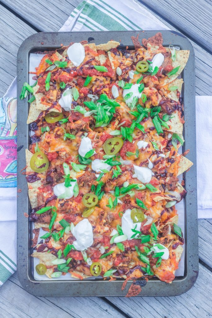 Sheet-Pan Barbecue Pulled Pork Nachos. Leftover pulled pork, barbecue sauce, and favorite toppings on a bed of tortilla chips.