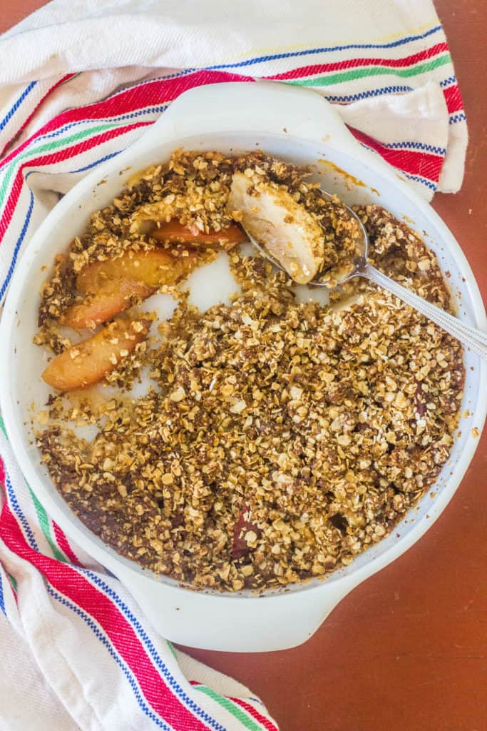 Apple and Plum Oatmeal Crumble. Fresh fruit topped with an oatmeal, butter and brown sugar topping and baked.
