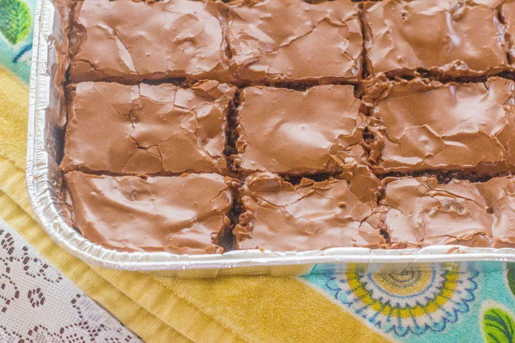 Iced Mocha Brownies. Big batch brownies made from scratch with two different kinds of chocolate plus just enough coffee for a rich mocha flavor. Iced with easy chocolate homemade frosting. Plus, tips for making the world's best brownies.