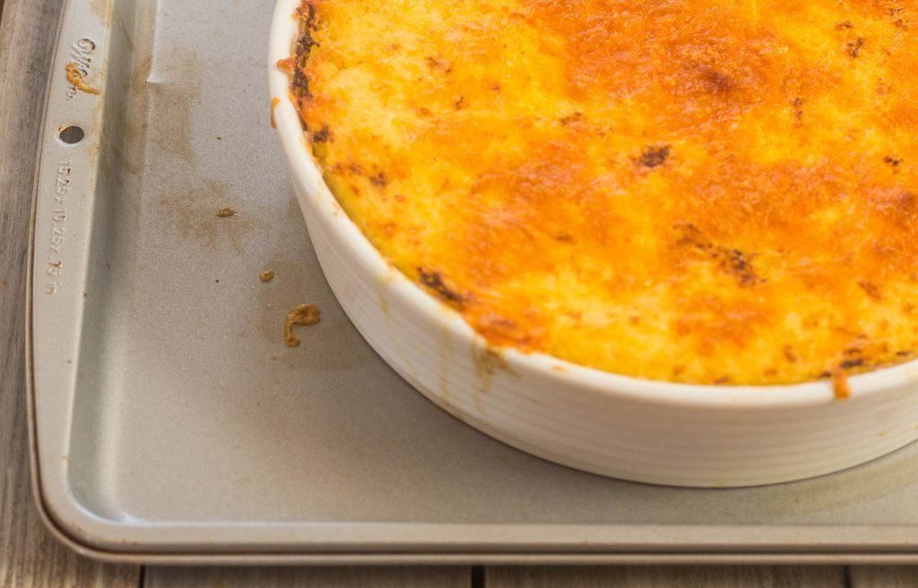 Cheese Grits Casserole in baking dish.
