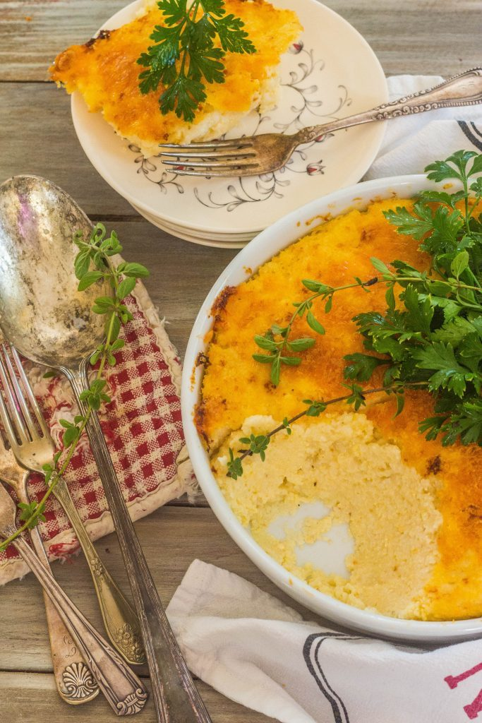 Cheese Grits Casserole on plate with fork.