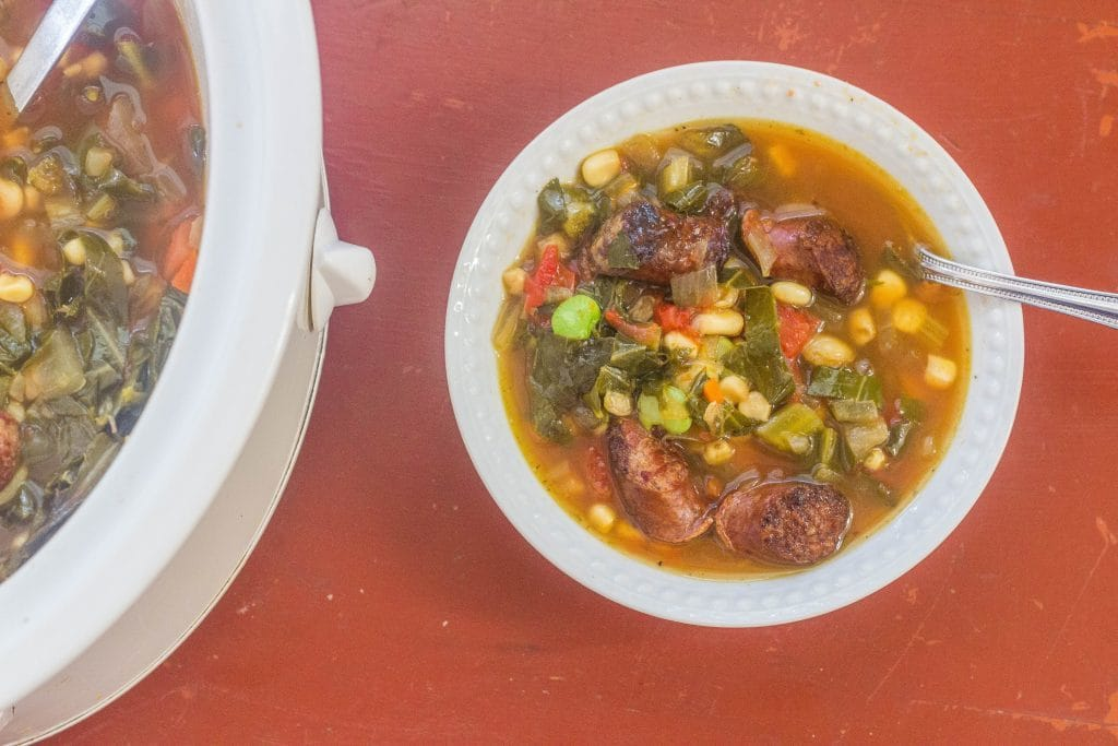 Slow-Cooker Sausage and Succotash Soup with Collards. Smoked country sausage, corn, butterbeans, and collards are part of this hardy slow-cooker meal.