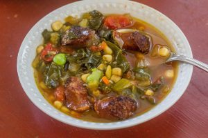Slow-Cooker Sausage and Succotash Soup with Collards.. Smoked country sausage with corn, butterbeans, and collards in a slow-cooker meal.