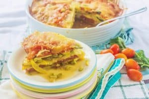 Southern Summer Vegetable Casserole. Favorite southern vegetables (tomatoes, yellow squash, zucchini, sweet onions) layered with fresh herbs and cheese.