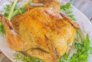 Roasted Whole Chicken is a dish that everyone who cooks chicken needs in their stable of dishes they've perfected. It's roasted simply in a cast iron skillet with a seasoning mix and melted butter.