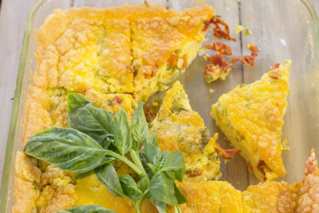 Jalapeno Cheddar Tomato Basil Frittata is a smooth and creamy egg and cheese recipe topped with pickled jalapeno peppers, sun-dried tomatoes,and fresh basil. Is suited for breakfast, brunch, or as an appetizer.