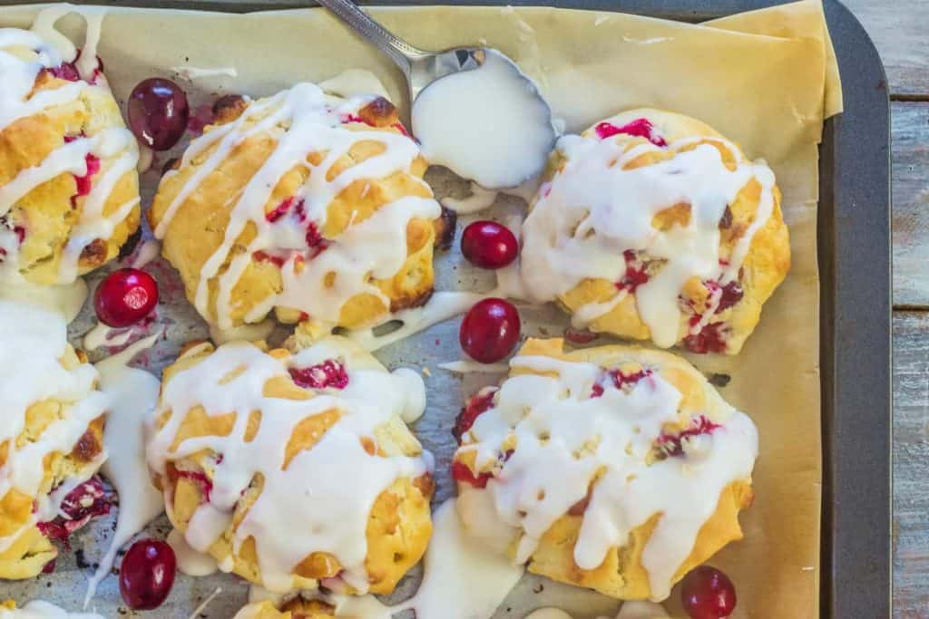 Christmas Cranberry White Chocolate Sour Cream Biscuits are the perfect balance of tart and sweet.  Sour cream makes the texture as light and fluffy as air. No rolling or cutting required.