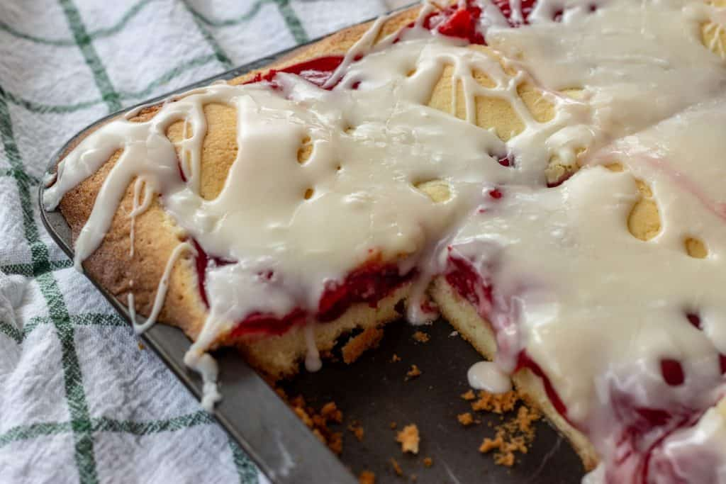 Cherry Pie Bars with Buttermilk Glaze in baking pan